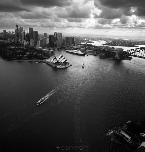Sydney from 1000 Feet - Photographed from a helicopter with  a Rolleiflex at  1/500 seat f11 to eliminate camera shake .The Prime Ministers residence is...