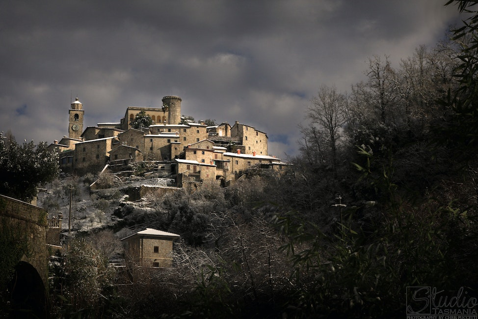 Castello di Bagnone - Hidden away in far northern Tuscany, the medieval town of Bagnone graces the Apuan hillside, shrouded in winter snow