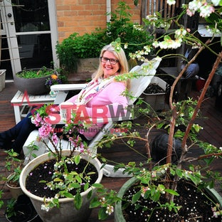 Donna Livermore in her deck garden - Photos by Joe Mastroianni
