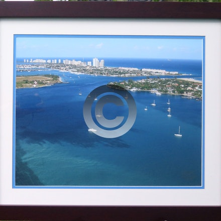 LAKE WORTH INLET - Lake Worth Inlet framed in our house mahogany frame with double mats and regular glass. $125.00.